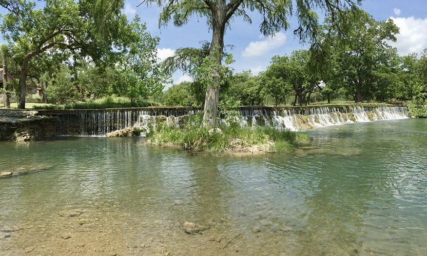 Why You Need to Take a Dip in the Cypress Falls Swimming Hole